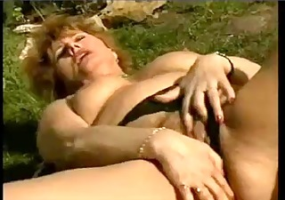 moist older wife masturbating in the garden by