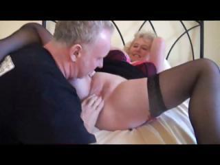 blonde grandma in black stockings receives