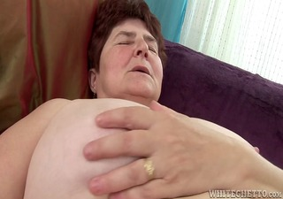 horny granny gets her hairy pussy soaked has she