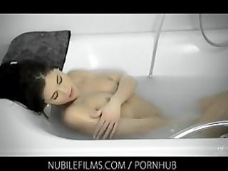 caprice alone in the bathroom