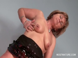 golden-haired slutty mature pleasuring her hungry