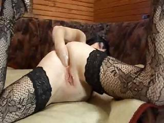 mature brunette bitch in lacy nylons fists her