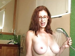 nasty redhead milf with glasses gets cum on her