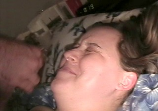 wife takes a facial on the bed.
