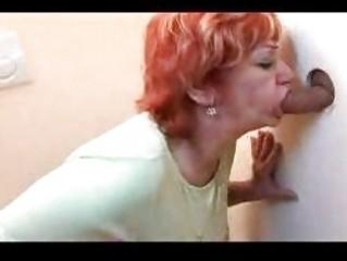redhead mature gangbanged through gloryhole