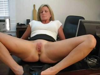 aged blonde secretary widens her legs and