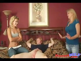mother and daughter give young lad handjob