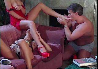 businessman licking two sluts feet